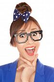 Photo of a funny surprised nerdy girl wearing 8 bit glasses