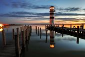stock photo of reflection  - Lighthouse at night in Austria  - JPG