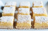 image of tarts  - Fresh baked Meyer lemon bars with powdered sugar - JPG