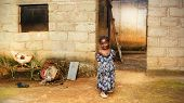 stock photo of cinder block  - Black African girl at home, third world or poverty concept