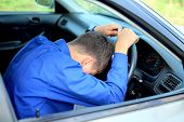 image of nod  - young man fall asleep in a car - JPG