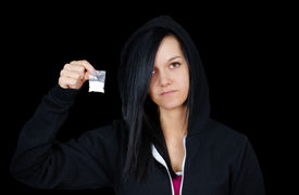 pic of methadone  - Gloomy young woman or teen addict with drugs on black - JPG