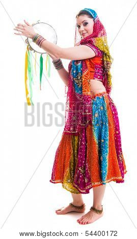 Bollywood dancer in traditional beautiful multicolored dress with veil and tambourine