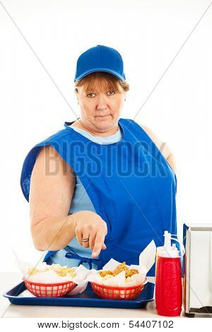 Unfriendly, no-nonsense cashier at a fast food restaurant, serving your order.  Isolated on white.
