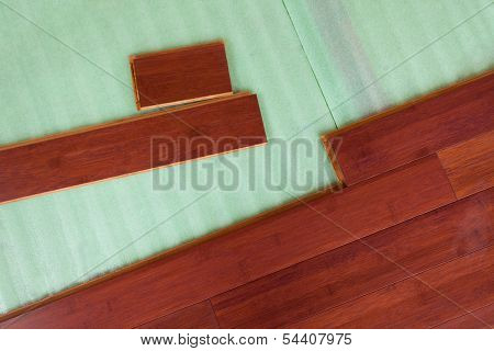 Wooden Bamboo Hardwood Flooring Planks Being Layed