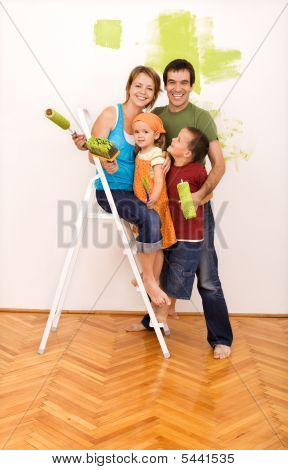 Happy Family Painting Their New Home Together