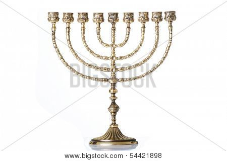 Candlestick with nine arms and white candles( chanukkiah / hanukiah for chanuka / hannukah - ????? ).Isolated on white.