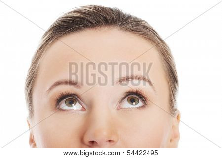 Woman's face, cut out composition. She's looking up. Isolated on white.