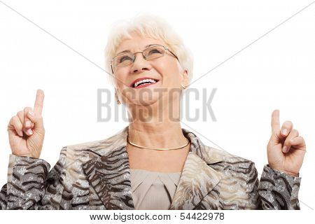 An old woman pointing up with fingers. Isolated on white.