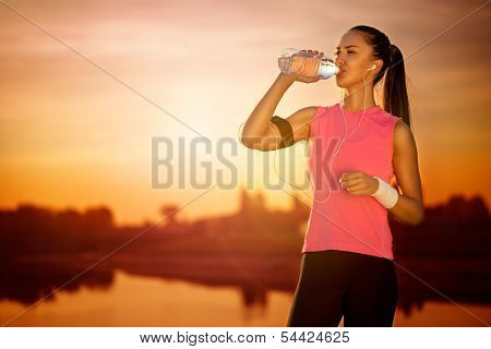 Thirsty female runner, outdoor