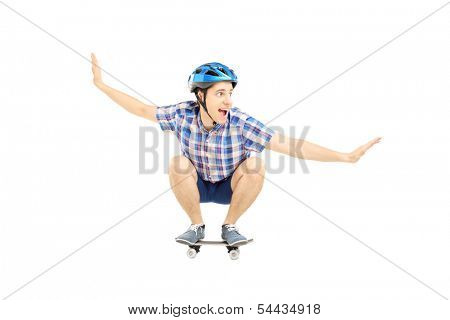 Young smiling male with helmet skating on a skate board isolated on white background