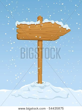 Wooden sign with falling snow
