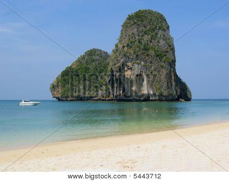 Beach With Mountainous Island