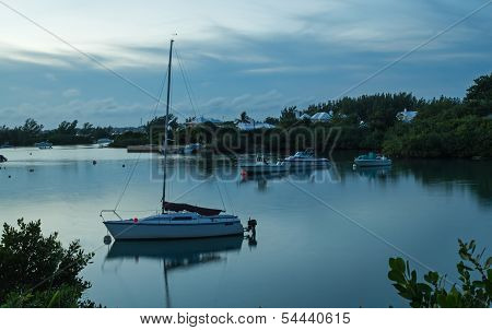Boat in a Calm Harbour at Dawn