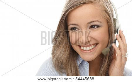Closeup portrait of smiling blonde dispatcher using headphones.