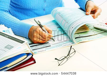 Hands of accountant in office. Accounting background.