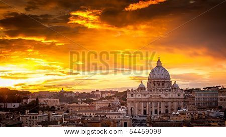 Basilica Of St. Peter At Sunset With The Vatican In The Background In Rome, Italy