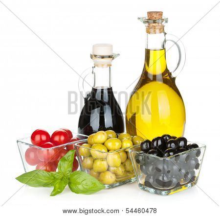 Olives, tomatoes, herbs and condiments. Isolated on white background