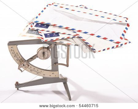 Antique Postage Scale With Airmail Letters With White Background