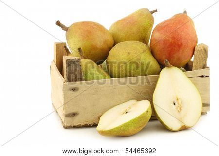 "fresh ""doyenne de comice"" pears and a cut one in a wooden crate on a white background"
