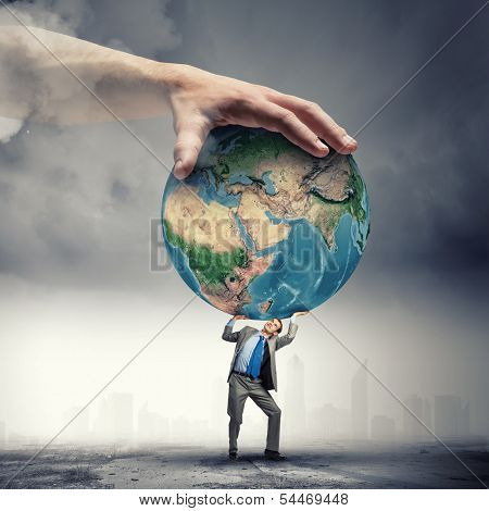 Image of young businessman under pressure of planet Earth. Elements of this image are furnished by NASA
