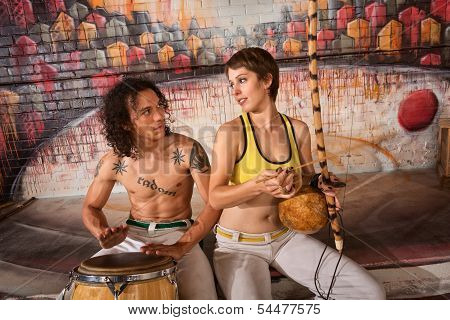 Capoeira Couple Playing Traditional Instruments