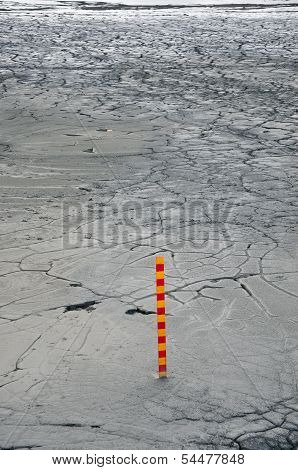 Polluted mud in a copper mine with a measurement scale