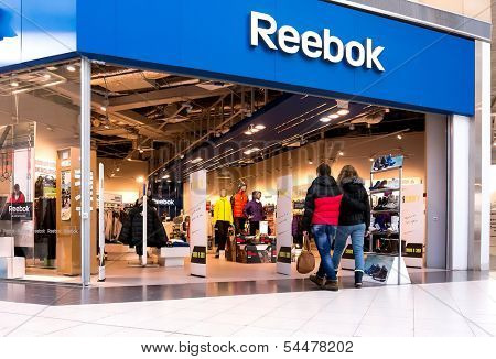 EKATERINBURG, RUSSIA - NOV 24: Shoppers visit Reebok Center in Mega Mall on Nov 24, 2013 in Ekaterinburg, Russia. Mega Mall is one of the biggest malls in Russia