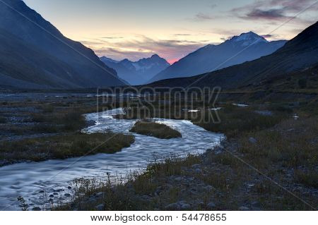 great mountain river with sunset