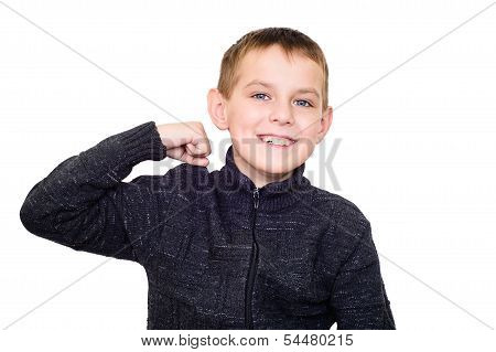 Close Up Portrait Of Strong Smiling Boy Showing Muscles