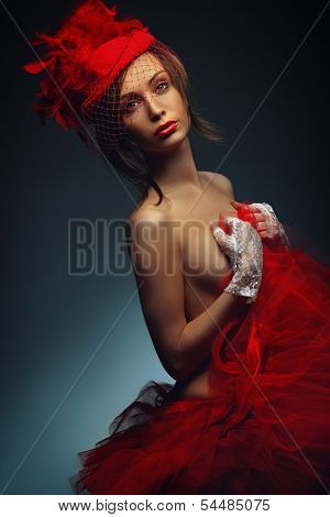 Beautiful sexy woman in red hat with net veil. Retro portrait