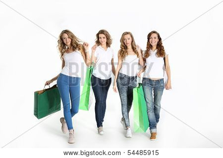 Group of the beautiful girlfriends shopping together