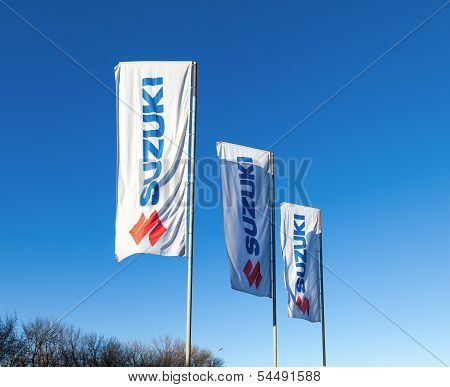 Samara, Russia - November 24: The Flags With Emblem Suzuki Over Blue Sky, November 24, 2013 In Samar