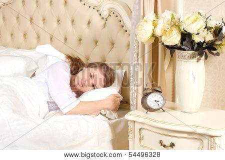 sleepy woman waking up