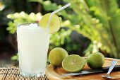 stock photo of fruit shake  - Lemon Lime juice smoothie shake in glass - JPG