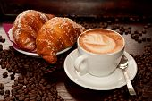 stock photo of croissant  - Cappuccino and croissant with coffee bean on wood - JPG
