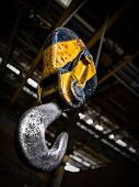 foto of crane hook  - Inindustrial Yellow Crane Hook In A Building - JPG