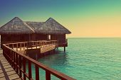 Maldives. Villa on piles on water with a retro effect