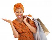 stock photo of traditional attire  - beautiful african woman in traditional clothes carrying shopping bags on white background - JPG