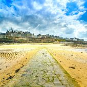 Saint Malo Beach And Stone Pathway, Low Tide. Brittany, France.