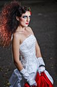 image of carnal  - Attractive bride in a wedding dress with bright makeup red shawl - JPG