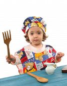 Little Girl Cooking Dressed At A Cheff poster