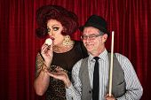 stock photo of cross-dressing  - Cross dressing man kissing cue ball with smiling friend - JPG
