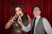 picture of drag-queen  - Hungry drag queen and friend holding cupcake - JPG