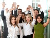 stock photo of applause  - business team in an office full of success looking happy - JPG