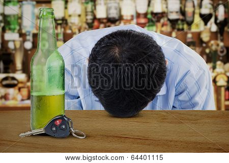 Alcoholic Young Man In Bar