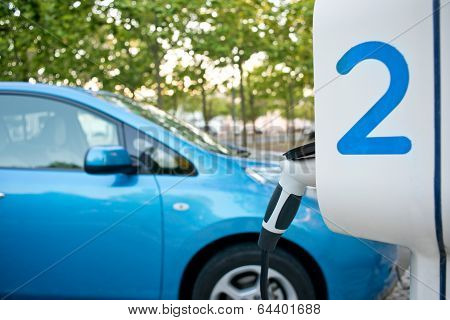Electric Car Being Recharged On A Service Station