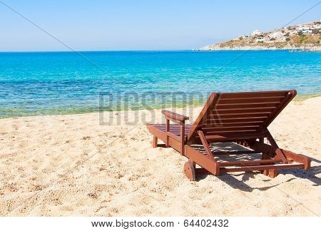 The Sandy Beach Near The Blue Sea With Sun Beds. Mykonos