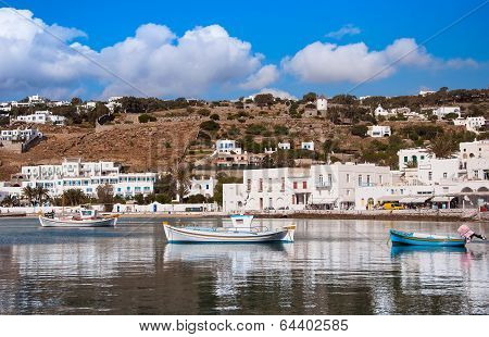 Boats In The Sea Bay Near The Town Of Mykonos In Greece Against The Sky With Clouds