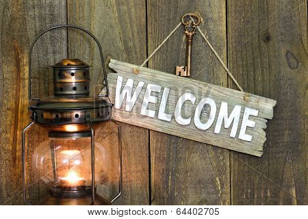 Welcome sign by glowing antique lantern